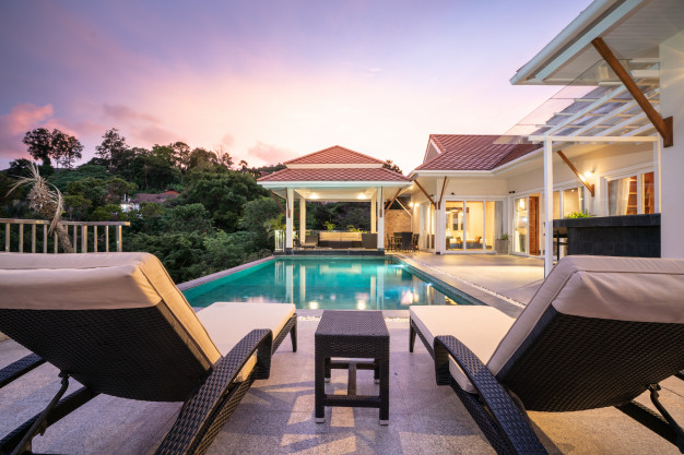 home-house-exterior-design-showing-tropical-pool-villa-with-sun-bed_41487-564